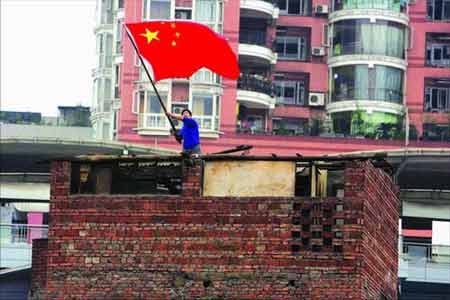 man waving chinese flag