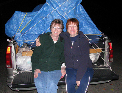 Lorelle and Lynda Kay VanFossen with a truck load of furniture from the Goodwill Outlet