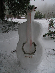 Snow Guitar carved by Lorelle VanFossen